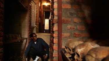 What lies beneath ... Igiraneza Bonus, 20, sits in the crypt under the Nyamata church, where his family was slaughtered in 1994.