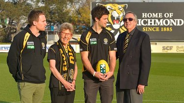 Joan Chapple and Arthur Bonser, members for more than 60 years, join Nathan Foley (left) and Trent Cotchin at Tigerland.