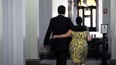 Ted Baillieu with a staff member on Wednesday night.