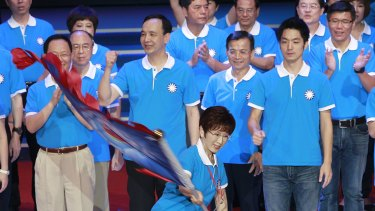 Hung Hsiu-chu, a former teacher and current deputy legislative speaker, waves a flag as she is nominated as the Nationalist party's candidate earlier this month.