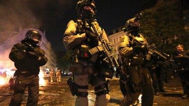 Heavily armed police patrol Hamburg on Friday night.