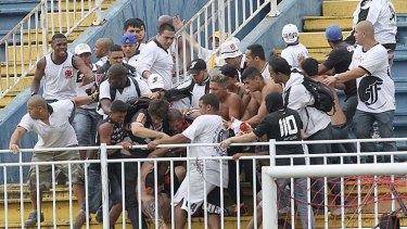 Vasco da Gama soccer fans beat up an Atletico Paranaense fan.