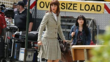 She ain't afraid of no ghosts ... Kristen Wiig plays an academic with an interest in the supernatural.