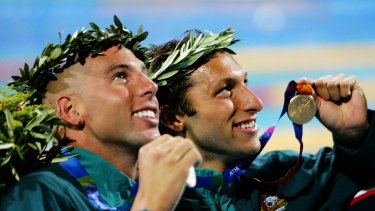 Grant Hackett and Ian Thorpe celebrate medals at the Athens Olympics in 2004.