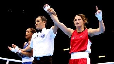Fightin' Irish ... Katie Taylor defeated Britain's Natasha Jonas 26-15 to advance to the semi-final of the women's lightweight competition, where she meets Tajikistan's Mavzuna Chorieva.