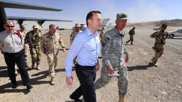 In the war zone: Opposition Leader Tony Abbott is accompanied by Colonel Jim Creighton, commander of Combined Team Uruzgan, who welcomed him to Tarin Kowt.