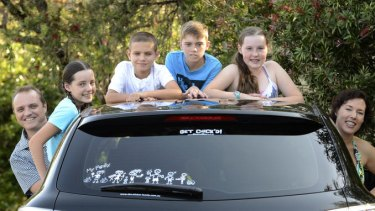 Monica Liebenow and husband Phil Barham, pictured with their children (left to right) Amber, Sam, Jack and Erin, are the creators of the 'My Family' bumper stickers, which are now being exported overseas.