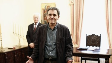 Euclid Tsakalotos, Greece's finance minister, takes a political oath following his appointment at the Presidential Palace in Athens.