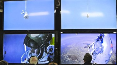 Near-perfect jump ... Felix Baumgartner is seen in the capsule before his leap.