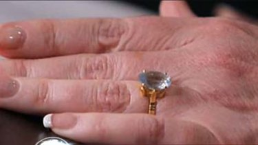 Wedding bells? . . . a diamond ring on Julia Gillard's finger raises speculation that the PM may be heading down the aisle.