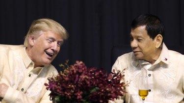 Donald Trump, left, talks with Philippine President Rodrigo Duterte during the gala dinner marking ASEAN's 50th anniversary.