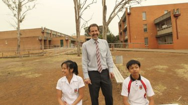 The principal Peter Ezzy of Plumpton High with students Christy Velasco who is in year 10 and her brother Joma who is in year 8. The school will receive one of the biggest increases in disadvantage loadings in 2014.