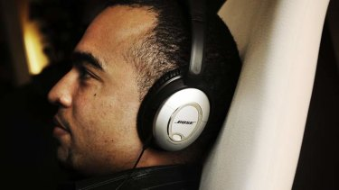 Ditch the crappy economy earbuds for a pair of noise-cancelling headphones.