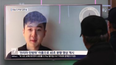 People at a railway station in Seoul, South Korea, watch a TV news program showing Kim Han Sol's video on Wednesday.