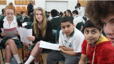 Don't do that ... Kate O'Reilly, of Randwick Girls, talks to Randwick Boys year 7 students about behaviour girls find unacceptable.