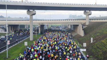Traffic jam: An estimated 100,000 people walked, ran or cycled along the EastLink freeway at an open day yesterday.
