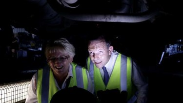 Opposition Leader Tony Abbott during a visit to a transport company in Rockhampton, Queensland, on Saturday.