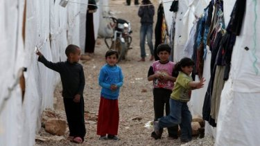 Syrian children outside their tents at a refugee camp in the city of Arsal, Lebanon.