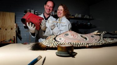 Conservators Andrew Pearce and Victoria Gill at their shop Endangered Heritage in Phillip.