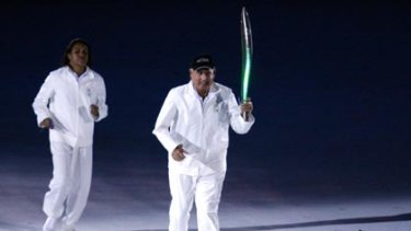 Gold Coast Mayor Ron Clarke carries the baton at the 2006 Commonwealth Games in Melbourne.