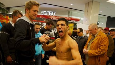 Billy Dib stirring up the crowd during the weigh-in for his fight against Jorge Lacierva of Mexico in July.