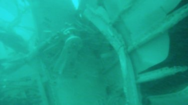 Images of the plane's wreckage under water have been released.