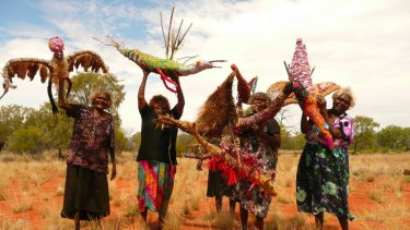 Women of the Tjanpi Desert Weavers show off their work.
