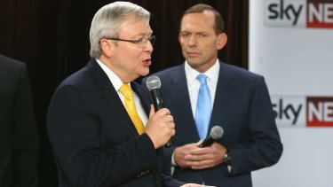 Prime Minister Kevin Rudd and Opposition Leader Tony Abbott during the People's Forum at the Broncos Leagues Club in Brisbane.