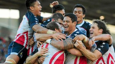 The USA team celebrate after Clint Newton scored a try against Wales during the World Cup. The team represented the USA under the umbrella of the AMNRL.