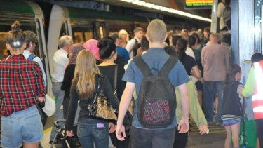 Passengers pack the Perth Underground on free public transport day.