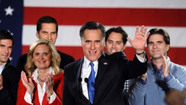 Poll position ...  Mitt Romney, wife Ann, and four of their five sons, after his caucus night rally in Iowa.
