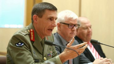 Operation Sovereign Borders chief Lieutenant-General Angus Campbell, doing the job of a minister.