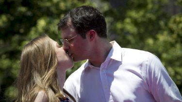 Chelsea Clinton kisses her busy investment banker husband Marc Mezvinsky.