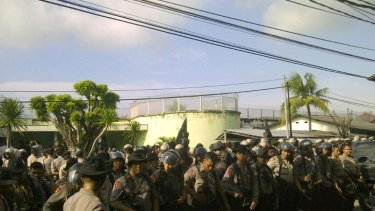 'Under control' ... Police outside the Kerobokan jail, where inmates are said to have been overpowered.
