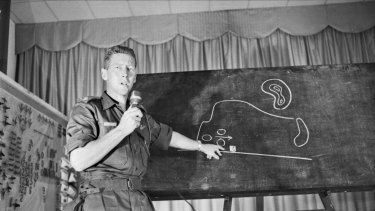 Major Harry Smith of Brisbane, Queensland briefing foreign press representatives on the battle of Long Tan in 1966 in Vietnam.