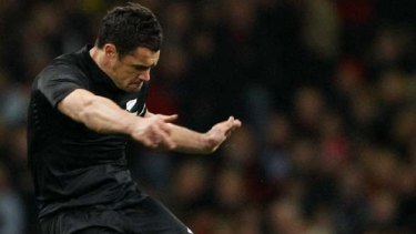 Dan Carter kicks a penalty goal against Wales to beat the world record of most points scored in test rugby.
