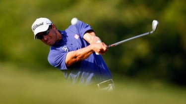 """Adam Scott hits a shot on the 14th hole during the first round of The Players Championship. """"I didn't tee off today thinking about No.1 because there is 72 holes before that could happen."""""""
