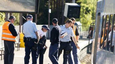 Police, paramedics and Metro Trains investigators at Tooronga Station in Melbourne where a one-year-old boy in a pram was struck by a train.