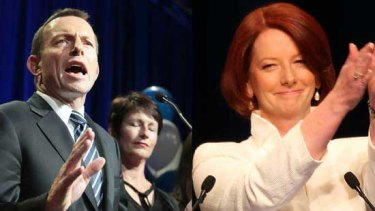 Julia Gillard last night accepts the applause of Labor Party faithful while Tony Abbott basks in the close result. <i>Pictures: Glen McCurtayne, Craig Sillitoe</i>
