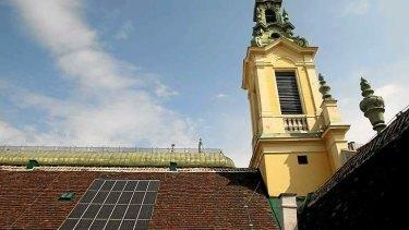 Solar panels on a church roof in Vienna, Austria.