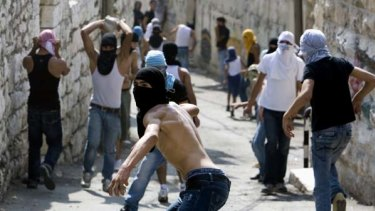 Clashes ... Palestinian youths throw stones in east Jerusalem.