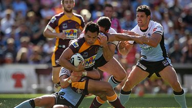 Who's watching? ... Ben Te'o is tackled at Suncorp Stadium this afternoon.