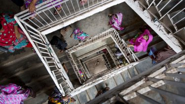 Bangladeshi workers leave for a lunch break at a garment factory in Dhaka.