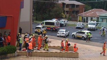 Emergency workers at the cinema in Bathurst after freeing nearly 40 people following a sudden storm.