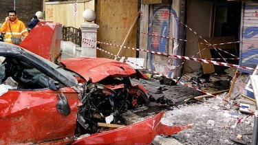 Instead of gently guiding the bright red Ferrari 599 GTO towards the Hotel Exedra, a mortified Roberto Cinti careered into a shop, trashing the car completely and badly damaging the shop front.