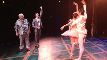 Queensland Ballet Artistic Director Li Cunxin and choreographer Ben Stevenson run principal dancers Meng Ningning and Hao Bin through their steps ahead of the opening of Cinderella in Brisbane.