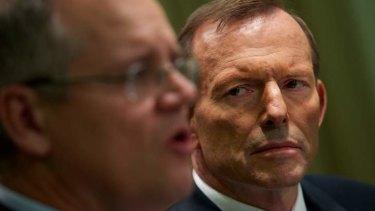 Tony Abbott and opposition immigration minister Scott Morrison.