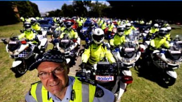 Speeding fine ... Ken Lay pictured at the head of his highway patrol troops in December.