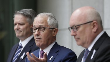 Prime Minister Malcolm Turnbull addresses the media during a joint press conference with Finance Minister Mathias Cormann and Attorney-General George Brandis on Tuesday.