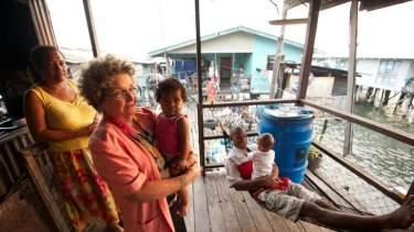 Dame Carol Kidu pictured with friends in the village of Pari, near the capital, Port Moresby.